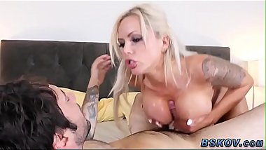 Busty pornstar blowing