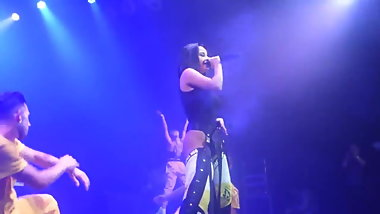 Becky G on stage in a thong