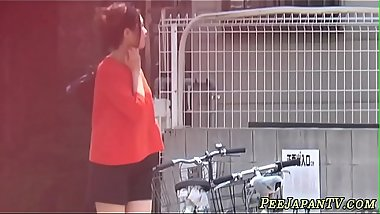 Bizarre asian whore pees in car park