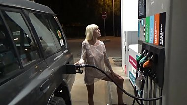 Blonde in a transparent dress fills the car at gas station