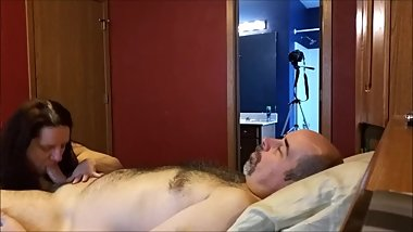 Husband Lays Back While Wife Licks His Balls and Sucks His Uncut Dick